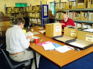 Photograph of researches working in the Glutton Bridge library